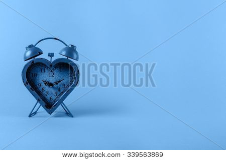 Heart Shaped Clock Toned In Classic Blue. Valentines Day And Love Infitity And Duration Concept. Hor