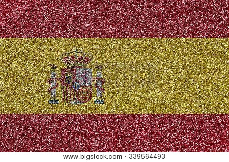 Spain Flag Depicted On Many Small Shiny Sequins. Colorful Festival Background For Party
