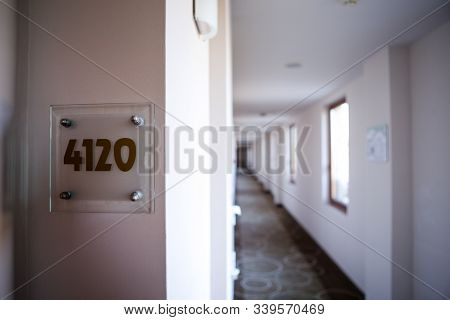 Shallow Depth Of Field (selective Focus) Image With A Room Number On The Hallway Of A Hotel