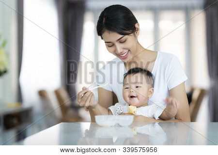 Asian Mother Feed Soup To Her Baby, This Image Can Use For Baby, Boy, Mom And Family Concept