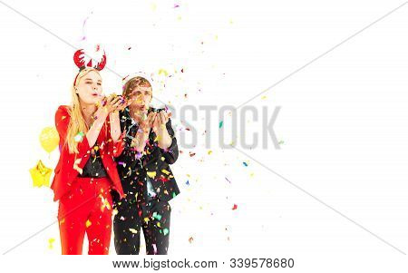 Young Couple Enjoy With Colorful Confetti In New Year Celebration Party