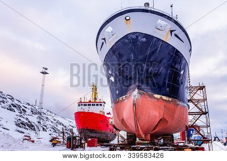 Fishing Ships Hulls In Dockyard On Maintenance During The Winter Time, Port Of Nuuk, Greenland