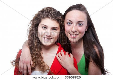 Two young girls happy isolated over white backround