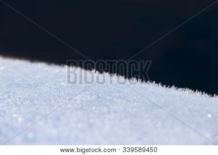 Texture Of Surface Covered With Hoar-frost In Winter. Background With Frozen Surface Covered By Hoar