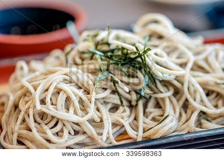 Cold Soba (buckwheat Noodles) Served On A Wickerwork Platter And Eaten After Being Dipped In A Cold