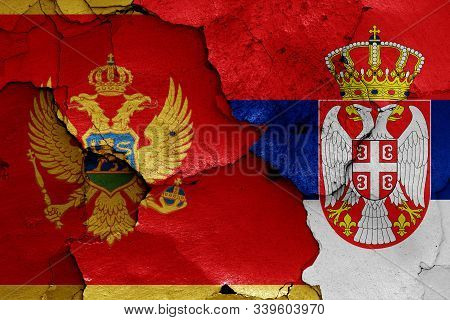 Flags Of Montenegro And Serbia Painted On Cracked Wall