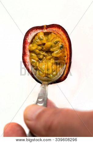 Passion Fruit ( Passiflora Edulis). Eat The Fruit With A Small Spoon