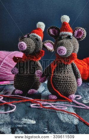 Lovely Handcrafted Amigurumi Rats With Christmas Hats And Red Scarves Standing Near To The Bright Ya