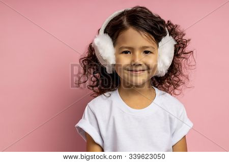 Close Up Studio Portrait Of Little Girl 5 Y.o. With Dark Curly Hair, Brown Skin, Cute Smile, Brown E