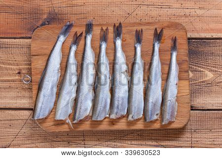 Step-by-step Preparation Of Fried Smelt In A Pan, Step 3 - Cutting Of Raw Smelt Fish, Top View, Sele