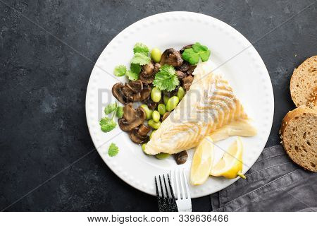 Fishplate. Sea White Cod Fish With A Side Dish Of Vegetables And Mushrooms On A Plate. Top View,