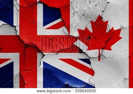 Flags Of Uk And Canada Painted On Cracked Wall