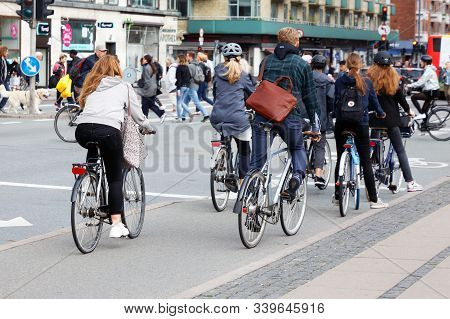 Copenhagen, Denmark - September 4, 2019: A Group Of Bicycle Riders Has Stopping For Trafic Light.