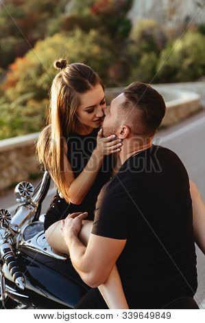 Portrait Of Beautiful Young Couple On A Motorcycle. Attractive Young Woman With Handsome Young Man O