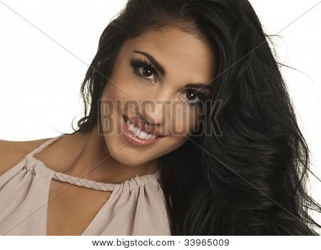 Face of a beautiful young woman smiling with gorgeous brunette hair.  Image isolated against white background.