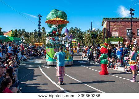 Orlando, Florida. December 07, 2019. Rosita,  Elmo An Dancers In Sesame Street Christmas Parade At S