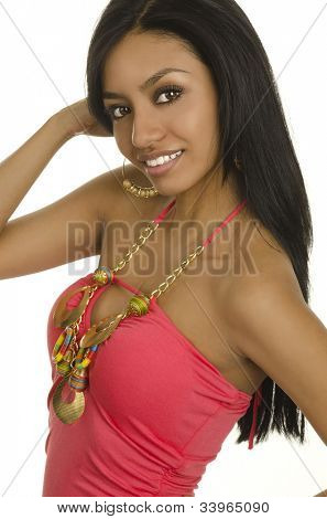 Beautiful exotic young woman in summer pink dress.  Image isolated against white background.
