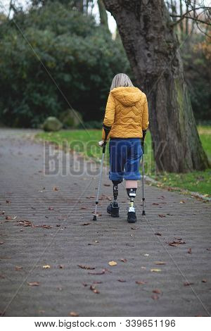 A Girl Without Legs Goes On Prostheses, A Strong Woman, The First Steps Of A Disabled Person.