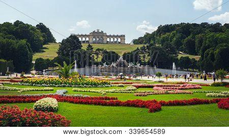 Vienna, Austria - August 20, 2019: Tourists Visit Beautiful Gardens Of Schonbrunn Palace. It Is A Fo