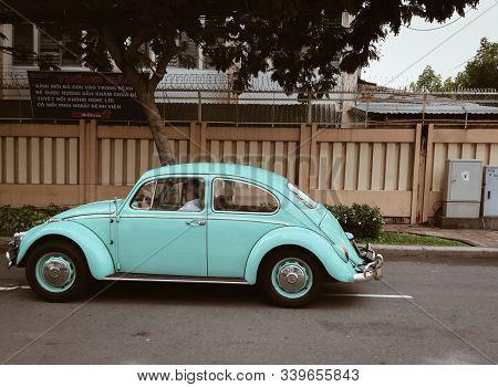 Saigon, Vietnam - Jun 21, 2015. A Small Vintage Blue Car On Street Of Saigon, Vietnam. Saigon Was Th