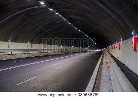 Tunnel. Vehicular Transport Passageway Under An Obstruction.