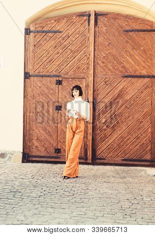 High Waisted Pants Fashion Trend. High Waisted Trousers. Woman Attractive Brunette Wear Fashionable