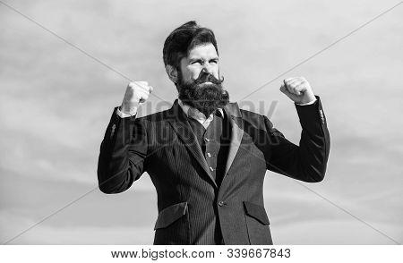 Success And Luck. Man Bearded Optimistic Businessman Wear Formal Suit Sky Background. Optimistic Moo