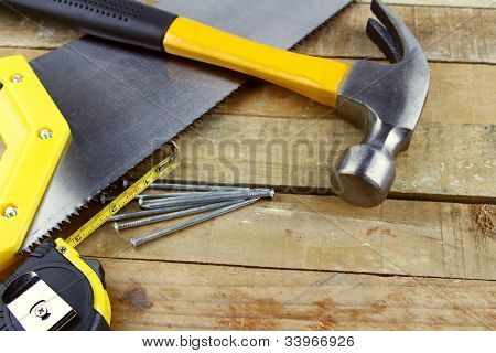 Assorted work tools on wooden decking