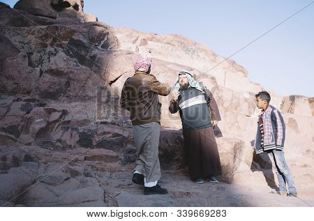 Mount Sinai, Sharm Ash Sheikh, Egypt - 25 October 2017. Young Residents Asking Tourist For Money On