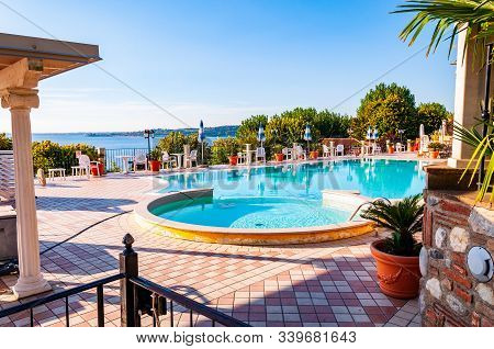 Camping La Ca, Garda Lake, Lombardy, Italy - September 12, 2019: Outdoor Pool With Vibrant Crystal W