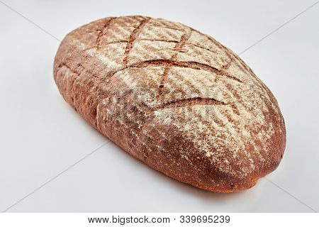Loaf Of Bread On White Background. Loaf Of Rye Bread With Flour. Artisan Bread Recipe.