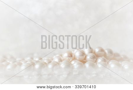 Nature White String Of Pearls On A Sparkling Background In Soft Focus, With Highlights