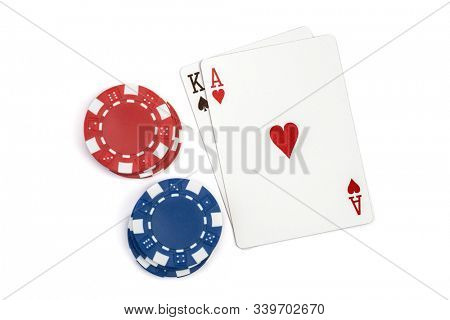 Win blackjack playing cards and casino poker chips isolated on white