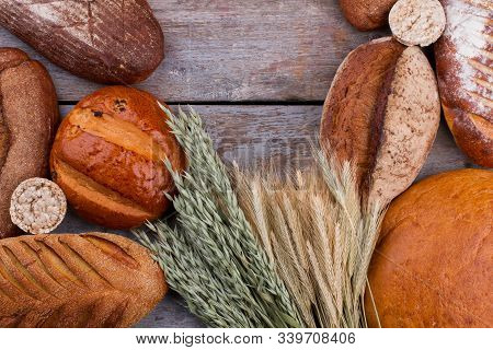 Assorted Artisan Bread And Wheat Ears. Healthy Whole Wheat Bread Assortment And Copy Space. Organic