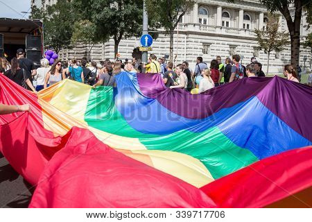 Belgrade, Serbia - September 18, 2016:  Crowd Of Protestors Holding A Giant Rainbow Gay Flag During