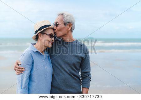 Kissing Moment Of Asian Couple Senior Elder Retirement Resting At Beach Honeymoon Family Together Ha