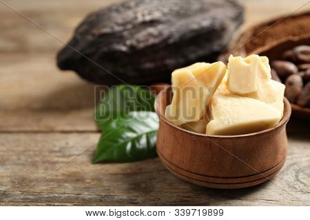 Organic Cocoa Butter On Wooden Table, Closeup. Space For Text