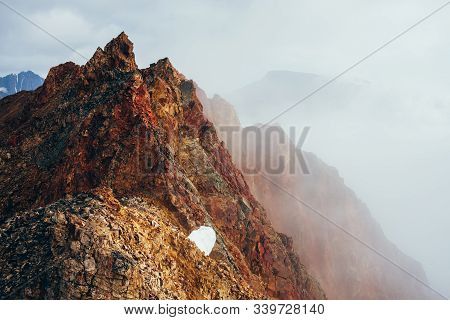 Beautiful Pointed Rocky Pinnacle In Cloudy Sky. Vivid Big Pointy Rocky Peak. Giant Piece Of Stone. A