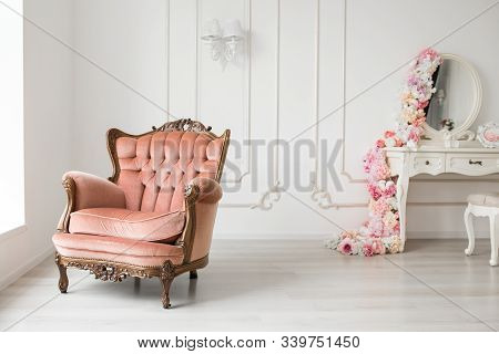 Vintage Antique Armchair And Antique White Chest Of Drawers In A White Room.