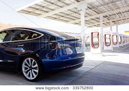 Kettleman City, Ca - April 28, 2019: Newest Navy Tesla Model 3 Charging At Supercharger Station