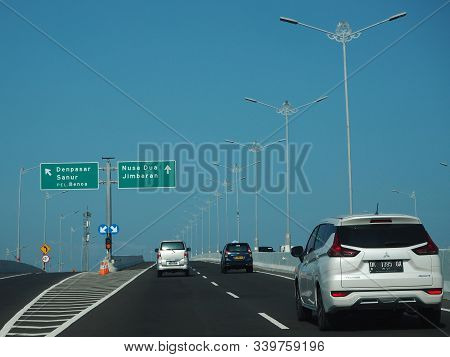 Denpasar, Indonesia - August 23, 2019: Vehicles Running On Bali Mandara Toll Road Which Carried By A