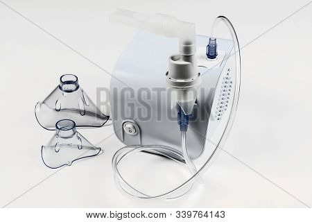 Medical Equipment For Inhalation With Respiratory Mask, Nebulizer On White Background.