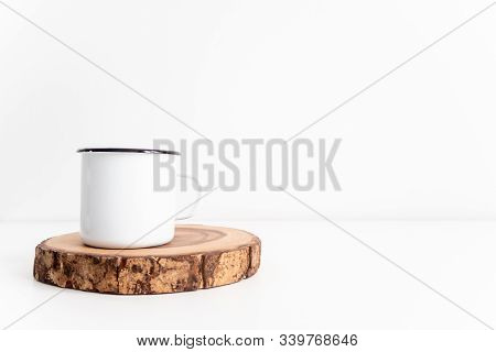Enamel White Mug On Rustic Wooden Cut Section Mockup. Boho Style Classic Stock Photo. Still Life Com