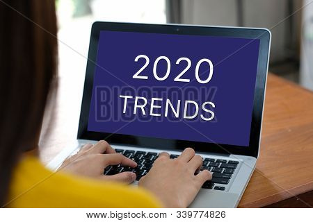 2020 Digital Trends, Woman Hand Tying Laptop Computer With 2020 Trends On Screen Background, Digital