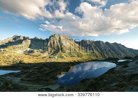 Panorama of Tatra Mountains sun sunset clouds Nature background landscape Nature background valley Nature background lake pond Nature background Travel Tourism scenery Nature background scenic Nature background sunrise Nature background summit mountain.