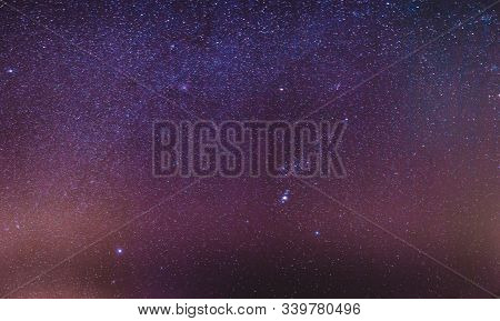Night Starry Sky With Glowing Stars. Night Starry Sky Background. Magenta Purple Colors.
