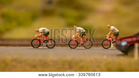Miniature people travellers with bicycle. Travel and Sport Concept. Miniature figure of men ride bicycles
