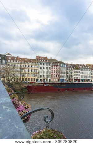 Strasbourg, Bas-rhin / France - 14. December, 2019: Vertical Strasbourg City View With River Barge A