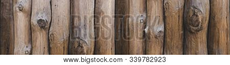 Seamlessly Tiling Wooden Wall Texture. Logs Are Arranged Vertically. A Wooden Palisade