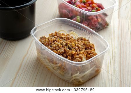 Pasta With Minced Meat And Onion In Navy-style And A Jar Of Vinaigrette. Food From Delivery.